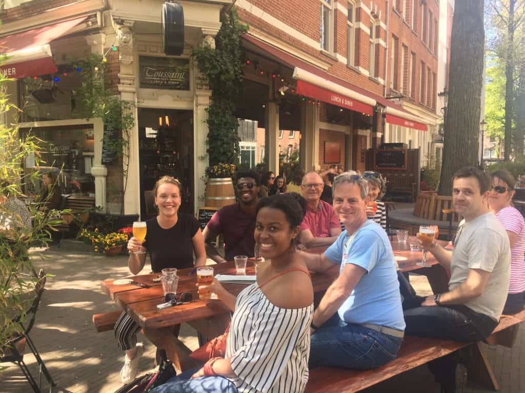 Tour guide Els and her group of bikers enjoying a refreshment break during our city bike tour.